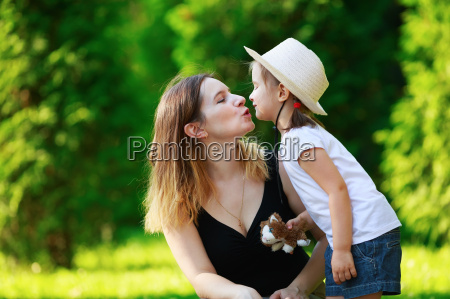 mother kisses daughter