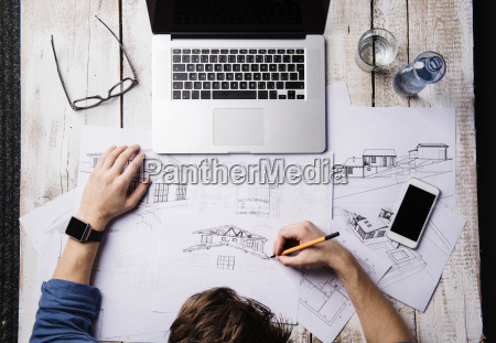 architect working at desk with laptop