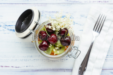 fruit salad in jar with grapes