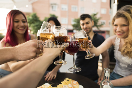 friends in a bar toasting with