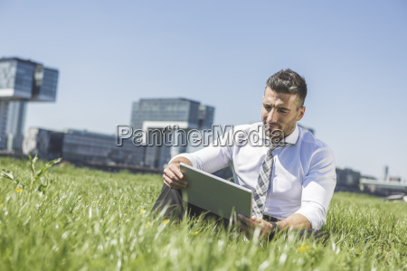 germany cologne businessman using digital tablet