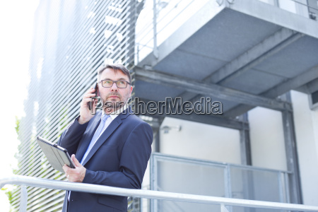 businessman on the phone outdoors