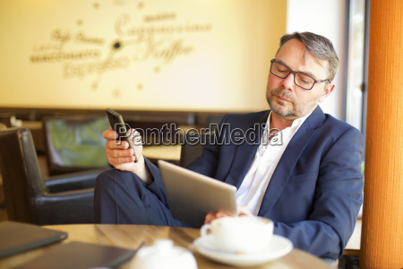 portrait of businessman with digital tablet