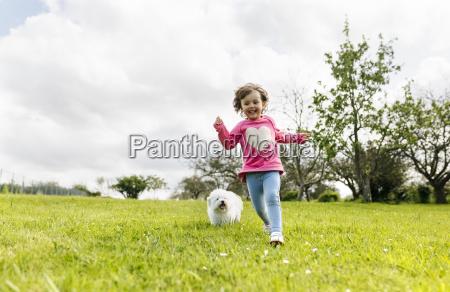 smiling little girl running on a