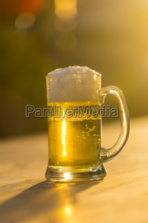 glass of fresh beer at evening