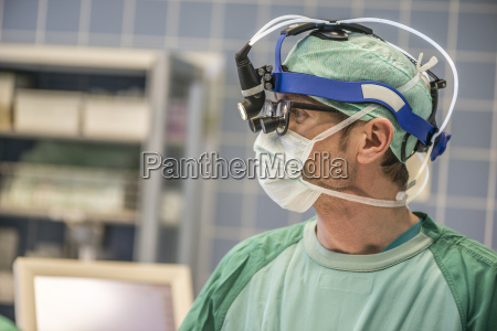 heart surgeon with head lamp in