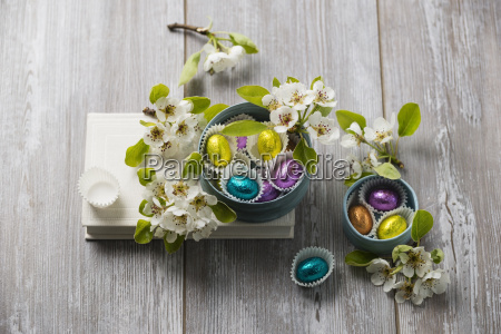 chocolate easter eggs and pear blossoms