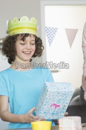 happy girl holding birthday present
