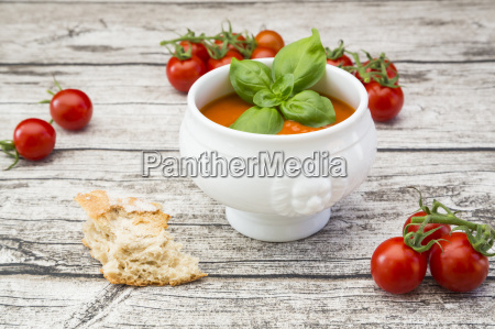 tomato soup and tomatoes on wood