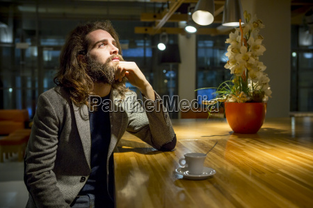 young hipster businessmamn waiting in cafeteria