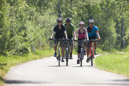 four people on a bicycle tour