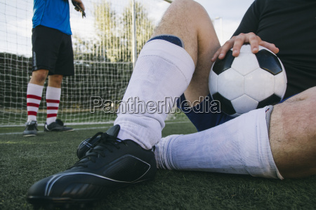 legs of a man with football