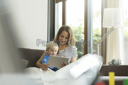 mother and son on couch with