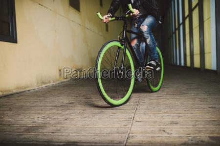 young man riding fixie bike