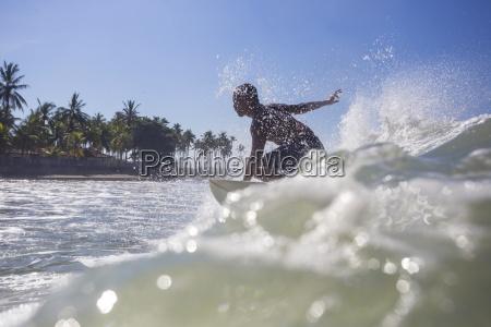 indonesia bali surfer on wave