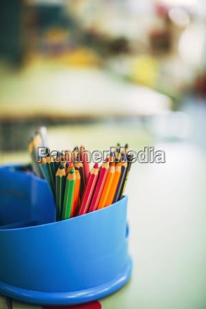 colour pencils in a penholder