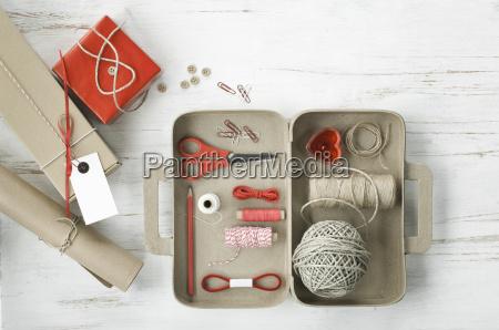 tinkering utensils in a cardboard box