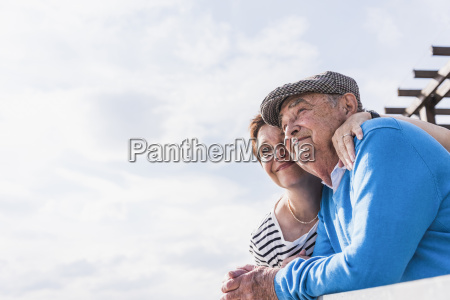 senior man and his daughter looking