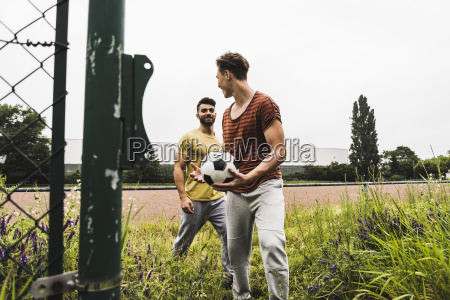two men at football ground