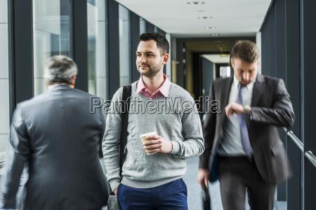 calm businessman in contrast to businessmen
