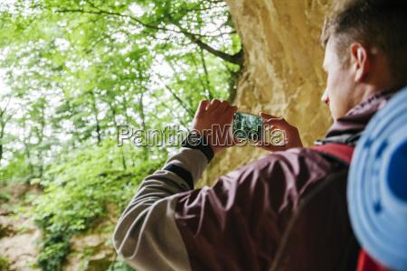 serbia rakovac young man hiking taking