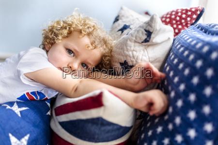 portrait of blond little boy relaxing