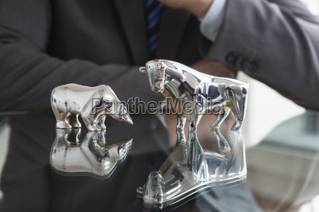 businessman observing stock market bull and