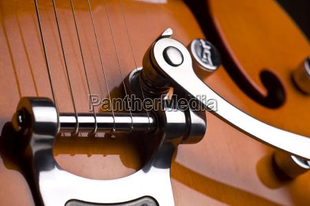 orange electrical guitar