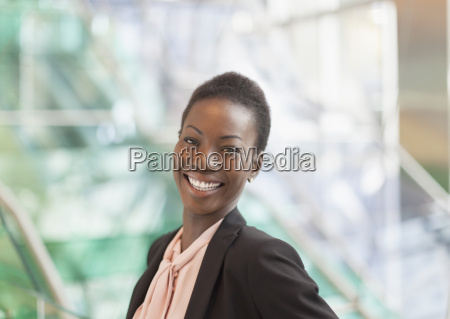 portrait smiling corporate businesswoman