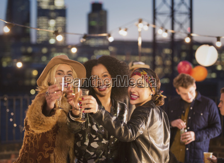 portrait enthusiastic young adult friends toasting