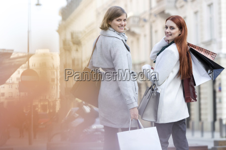 portrait of smiling women with shopping