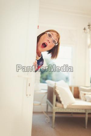 portrait playful mature woman peering behind