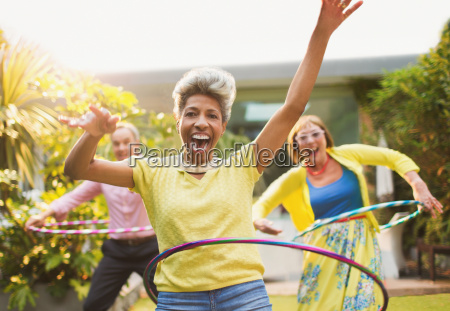 portrait playful mature adults spinning with