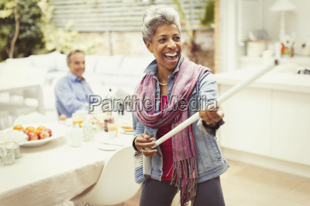 portrait playful mature woman playing air