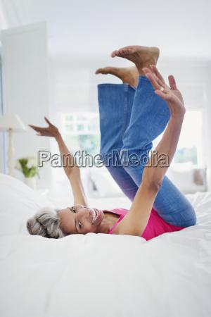 portrait playful mature woman falling onto