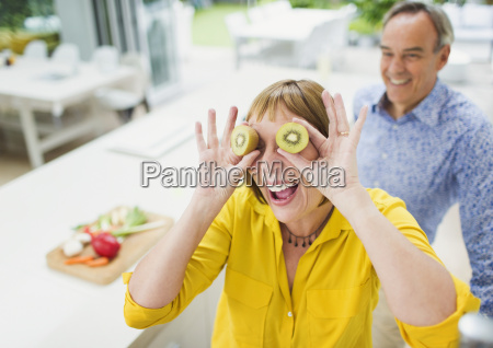 portrait playful mature woman covering eyes