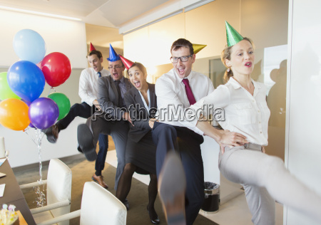 playful business people with party hats