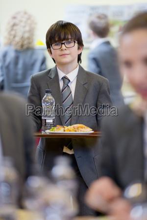 portrait confident middle school student eating