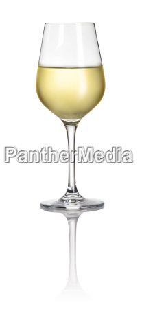 glass with white wine against white