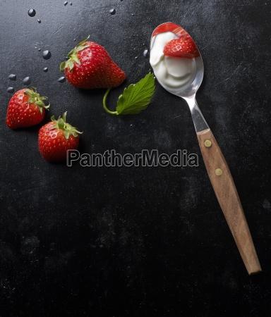 fresh strawberries and yoghurt on a