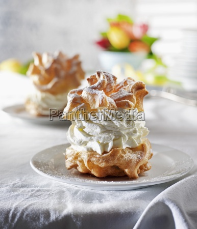 profiterole with whipped cream and icing