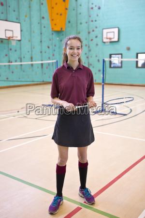 portrait smiling high school student holding