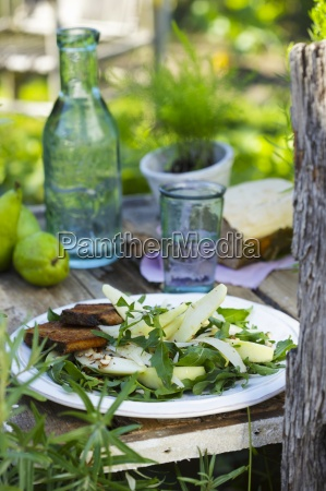 a salad with pears rockets parmesan