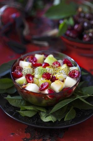 fruit salad with melon apple cherries