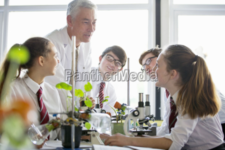teacher talking to high school students