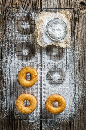 freshly baked doughnuts with icing sugar