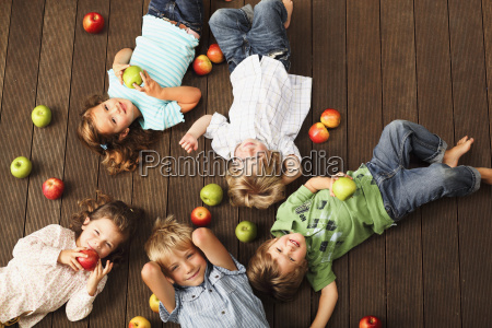 a group of young children laying