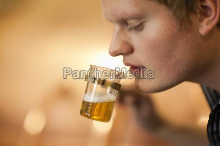 brewer testing a beer sample at