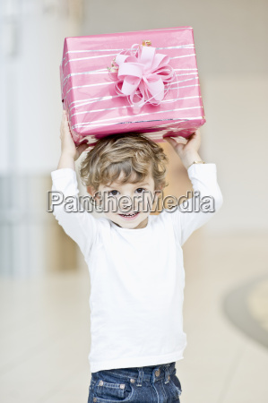 portrait of young boy holding present