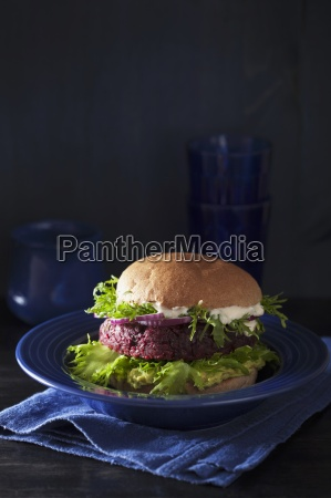 a veggie burger with a beetroot